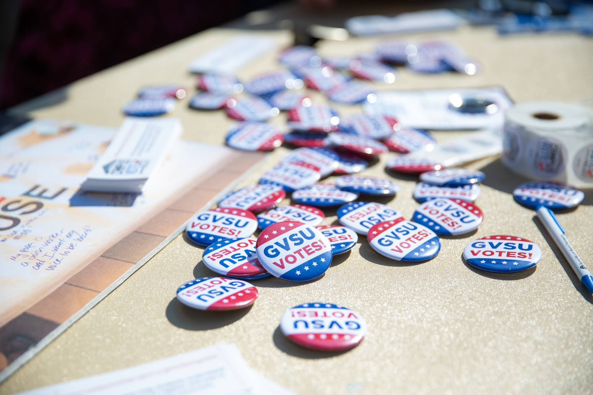 GVSU Votes buttons lying on table